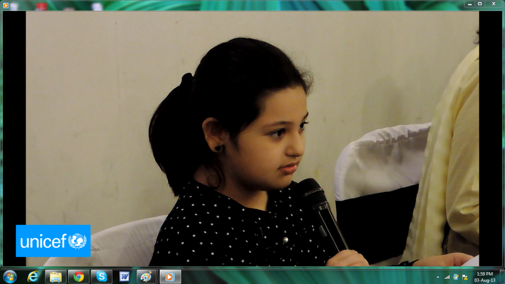 Dina gives her suggestions to grown ups in UNICEF!