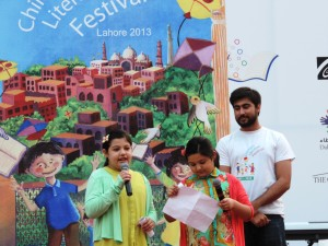 Amal reading aloud her poem at the Children's Literature Festival